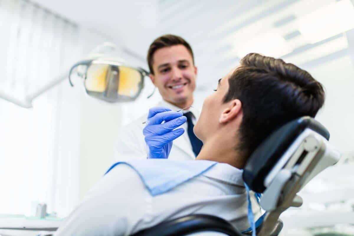 Dentist Fixing White Spots On Patient's Teeth